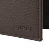 Gucci Men's Brown Dollar Calf Leather Bifold Coin Pocket Embossed Gucci Logo Wallet Gucci Logo 292534